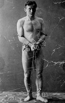 Harry Houdini before an escape act.
