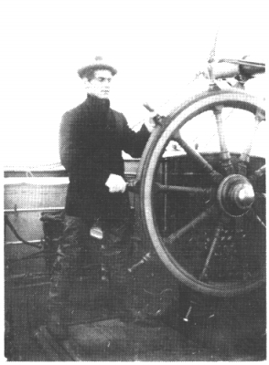 William Hope Hodgson at the wheel of a ship