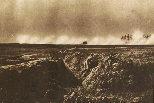 World War I soldiers in a trench near Craonne in 1917, with smoke from artillery on the horizon.