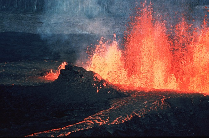 A volcanic fissure erupting in a curtain of lava and smoke.