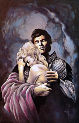A man in armor and a woman embracing.